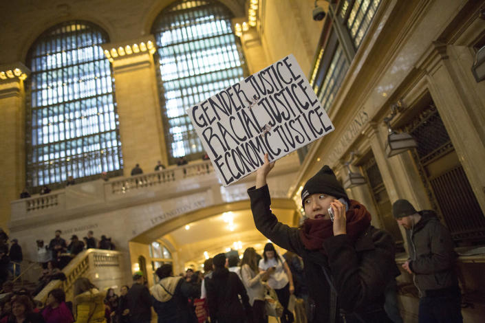 <p>A demonstrator holds up a sign inside Grand Central Terminal during a women's march, Saturday, Jan. 21, 2017, in New York. The march is being held in solidarity with similar events taking place in Washington and around the nation. (AP Photo/Mary Altaffer) </p>