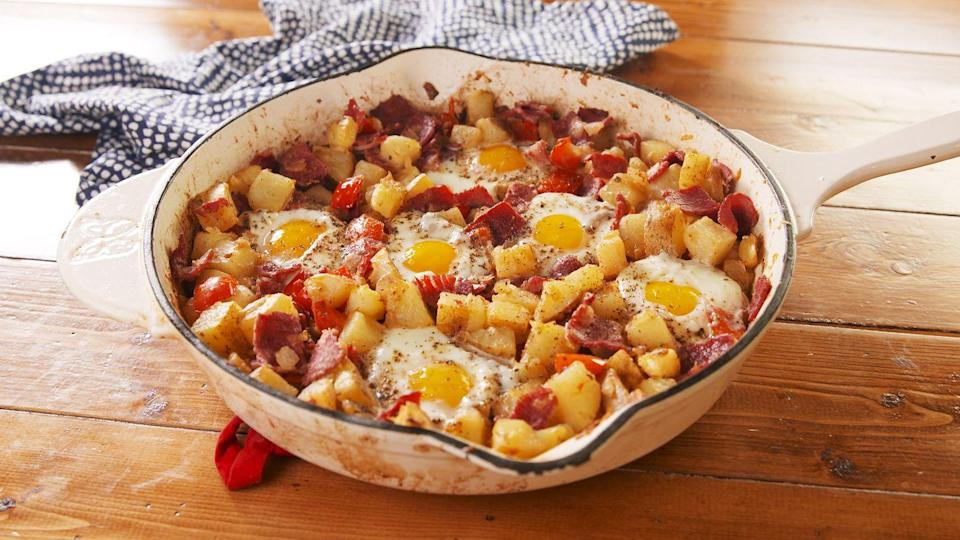 """<p>Breakfast for dinner? </p><p>Get the recipe from <a href=""""https://www.delish.com/cooking/recipe-ideas/a26311211/corned-beef-hash-and-eggs-recipe/"""" rel=""""nofollow noopener"""" target=""""_blank"""" data-ylk=""""slk:Delish"""" class=""""link rapid-noclick-resp"""">Delish</a>.</p>"""