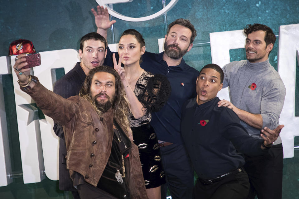 Actors Jason Momoa, from left, Ezra Miller, Gal Gadot, Ben Affleck, Ray Fisher and Henry Cavill pose for a selfie photograph at a photo call to promote the film 'Justice League', in London, Saturday, Nov. 3, 2017. (Photo by Vianney Le Caer/Invision/AP)