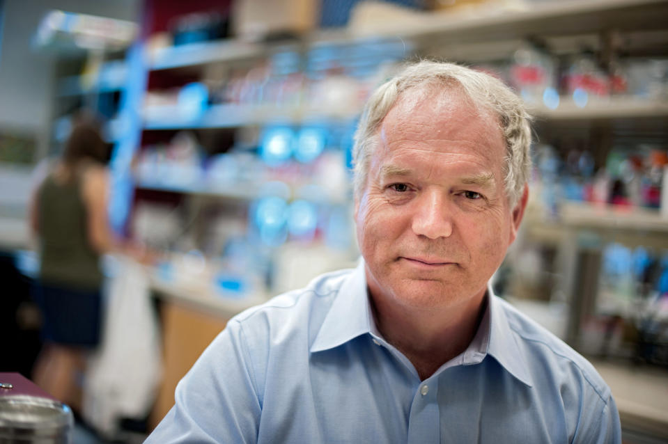 In this undated photo provided by the University of Alberta, Dr. Michael Houghton poses in his lab at Li Ka Shing Institute of Virology - University of Alberta, in Edmonton, Alberta, Canada. The British-born scientist and Americans Harvey J. Alter and Charles M. Rice jointly won the Nobel Prize for medicine on Monday, Oct. 5, 2020, for their discovery of the hepatitis C virus, a major source of liver disease that affects millions worldwide. (Richard Siemens/University of Alberta via AP)