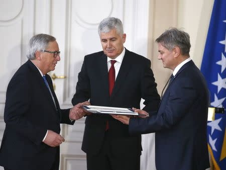 European Commission President Jean-Claude Juncker (L to R), the chairman of Bosnian Tripartite presidency Dragan Covic and Bosnian Prime Minister Denis Zvizdic during the official ceremony of answers to the European Commission's Questionnaire in Sarajevo, Bosnia and Herzegovina February 28, 2018. REUTERS/Dado Ruvic