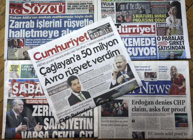 Turkish newspaper coverage on Nov. 30, 2017 of the trial in New York of a Turkish banker charged with violating U.S. sanctions against Iran. (AP Photo/Burhan Ozbilici)