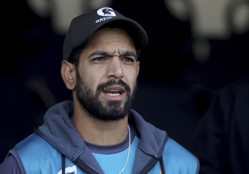 Pakistani cricketer Haris Rauf talks to media after a practice session in Lahore, Pakistan, Tuesday, Jan. 21, 2020. Pakistan's new pace sensation Rauf wants to play in all the three formats and hopes to carry his Big Bash League form into this week's Twenty20 series against Bangladesh at Lahore. (AP Photo/K.M. Chaudary)