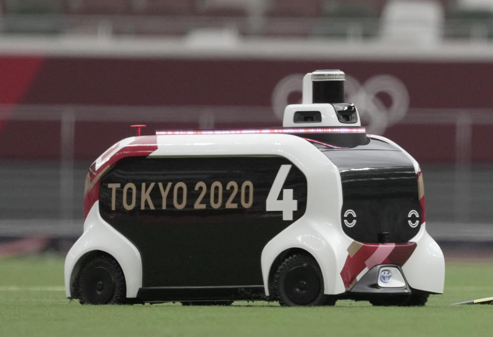 Jul 30, 2021; Tokyo, Japan; A remote control discus transporter in the infield during the Tokyo 2020 Olympic Summer Games at Olympic Stadium. Mandatory Credit: James Lang-USA TODAY Sports