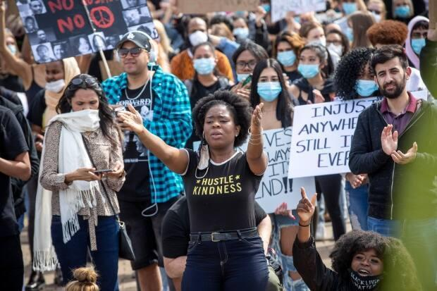 A woman gestures during a rally against anti-Black racism in Vancouver in the summer of 2020. (Ben Nelms/CBC - image credit)