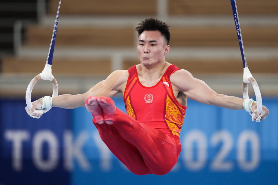 China's Sun Wei competes on the rings during men's artistic gymnastic qualifications at the 2020 Summer Olympics, Saturday, July 24, 2021, in Tokyo. (AP Photo/Ashley Landis)