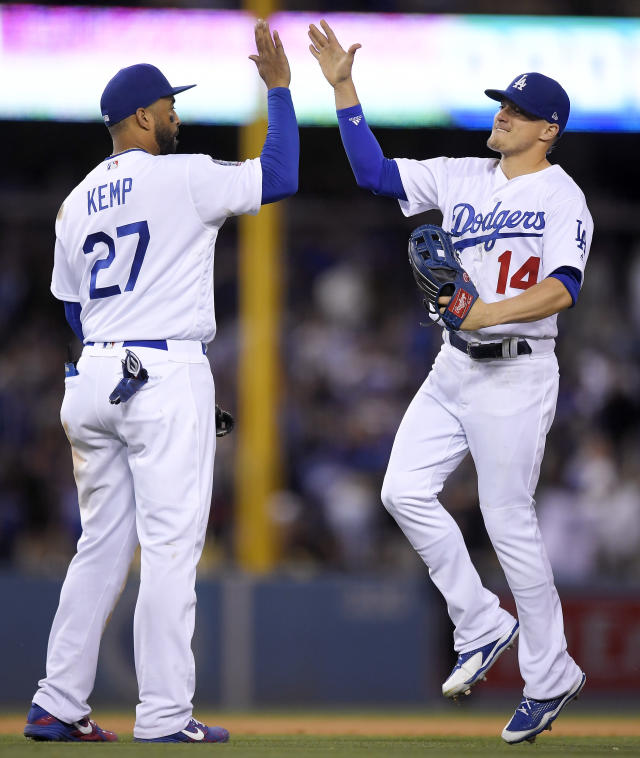 Los Angeles Dodgers' Matt Kemp, left, and Enrique Hernandez congratulate each other after they defeated the San Francisco Giants in a baseball game Saturday, June 16, 2018, in Los Angeles. (AP Photo/Mark J. Terrill)