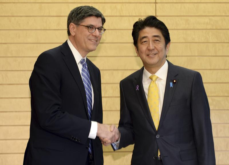 Jack Lew shakes hands with Shinzo Abe at the start of their meeting at Abe's official residence in Tokyo