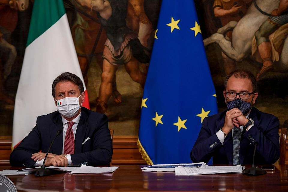 ROME, ITALY - AUGUST 7: Italian Prime Minister Giuseppe Conte and Italian Justice Minister Alfonso Bonafede wearing a protective mask hold a press conference after the Cabinet for the decree law August at Palazzo Chigi, on August 7, 2020 in Rome, Italy. (Photo by Antonio Masiello#POOL /Augusto Casasoli/ POOL via Getty Images ) (Photo: Antonio Masiello via Getty Images)