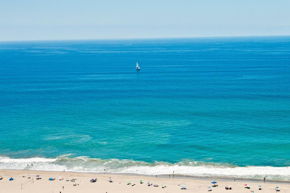 """<p><strong>Give us the wide-angle view: what kind of beach are we talking about?</strong><br> Will Rogers (named for the 1930s movie star) benefits from being between the Pacific Palisades and Topanga—it's a sort of no man's land that makes it less crowded than most of the nearby beaches, despite its proximity to <a href=""""https://www.cntraveler.com/activities/los-angeles/santa-monica-pier?mbid=synd_yahoo_rss"""" rel=""""nofollow noopener"""" target=""""_blank"""" data-ylk=""""slk:Santa Monica"""" class=""""link rapid-noclick-resp"""">Santa Monica</a>. There'll still be people there, but it won't feel like someone's always treading on your towel or standing in your sunlight. It's one of those big wide beaches with plenty of room for everyone to relax in the sun.</p> <p><strong>How accessible is it?</strong><br> One of the perks of Will Rogers is the parking lot is right next to the beach. It costs $9, but in LA it's almost unheard of to be able to park right next to the sand.</p> <p><strong>Decent services and facilities, would you say?</strong><br> There are clean bathrooms to change in and a number of beach volleyball courts, but otherwise you'll have to bring everything you need.</p> <p><strong>How's the actual beach stuff—sand and surf?</strong><br> The water is clean at Will Rogers, so it's a perfect place to take a dip on a sweltering day. It's also calm, so you won't find too many surfers. You will however, find a lot of beach volleyball players. Oh, and the beach was the filming site of Baywatch, so you'll definitely want to run in slow motion while pretending you're David Hasselhoff or Pam Anderson.</p> <p><strong>Can we go barefoot?</strong><br> The sand is sufficiently soft to walk around on barefoot, so throw down a beach towel and spread out.</p> <p><strong>Anything else we should know?</strong><br> There aren't a whole lot of food options, so it's best to take a picnic basket.</p> <p><strong>If we're thinking about going, what—and who—is this beach best for?</strong><br> This is """