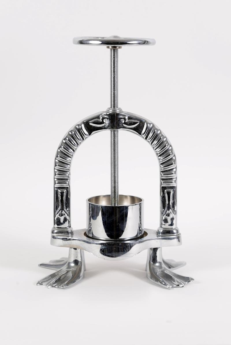 Anthony Bourdain's chrome duck press from the Paris episode of The Layover. The duck press is available for auction at igavelauctions.com October 9-30.