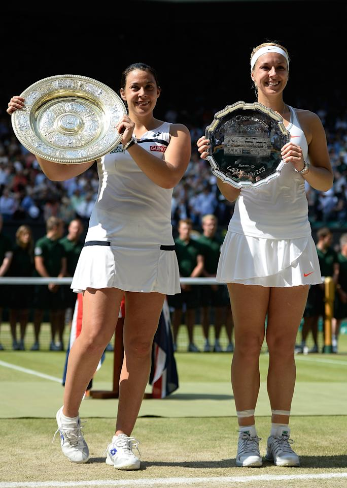 LONDON, ENGLAND - JULY 06: Marion Bartoli of France poses with the Venus Rosewater Dish trophy next to Sabine Lisicki of Germany and her runner-up trophy after their Ladies' Singles final match on day twelve of the Wimbledon Lawn Tennis Championships at the All England Lawn Tennis and Croquet Club on July 6, 2013 in London, England. (Photo by Dennis Grombkowski/Getty Images)