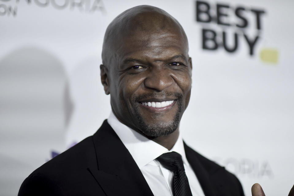 """FILE - In this Nov. 15, 2019 file photo, Terry Crews attends the 2019 Eva Longoria Foundation Dinner Gala in Los Angeles. Stay-at-home orders, traveling fears and the cancellation of sporting events, concerts and theme parks have forced the Make-a-Wish foundation to come to a stand-still, leaving young people's requests in holding patterns. The charity has introduced """"Messages of Hope,"""" encouraging the public and celebrities to record inspiring messages and upload them to social media, and so far, stars like Crews have already participated. (Photo by Richard Shotwell/Invision/AP, File)"""