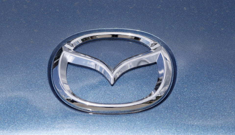 In this June 14, 2020, photograph, a Mazda company logo shines on the front of an unsold 2020 Miata at a Mazda dealership in Littleton, Colo. On Thursday, Nov. 19, Mazda beat traditional winners Lexus and Toyota to win top honors as the most dependable auto brand in Consumer Reports' annual reliability survey. Reports surveyed organization members who own more than 300,000 vehicles from model years 2000 to 2020. (AP Photo/David Zalubowski)