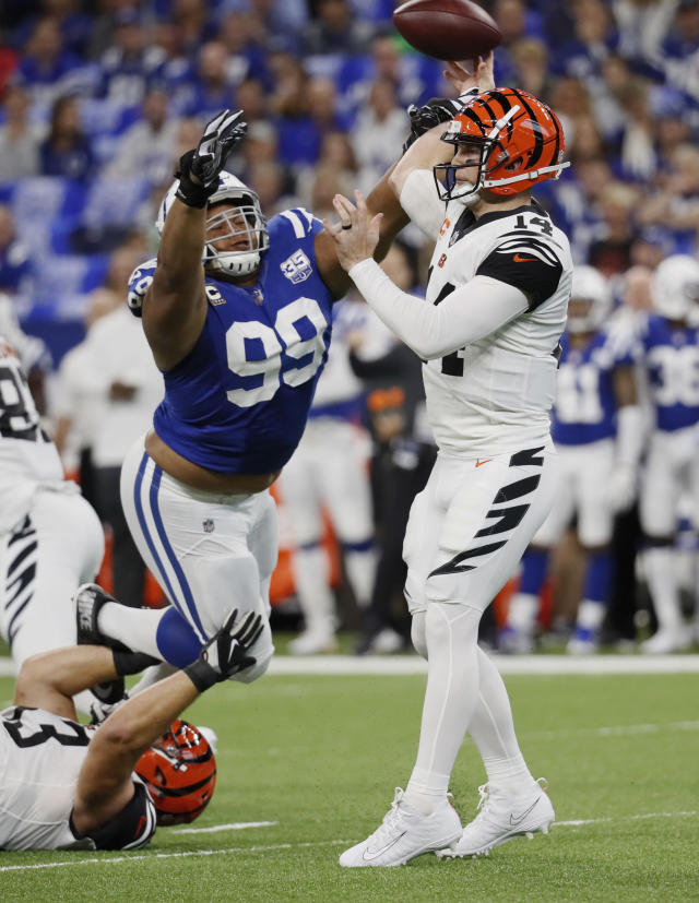 <p>Indianapolis Colts defensive tackle Al Woods (99) pressures Cincinnati Bengals quarterback Andy Dalton (14) during the first half of an NFL football game in Indianapolis, Sunday, Sept. 9, 2018.Dalton threw an interception on the play. (AP Photo/John Minchillo) </p>