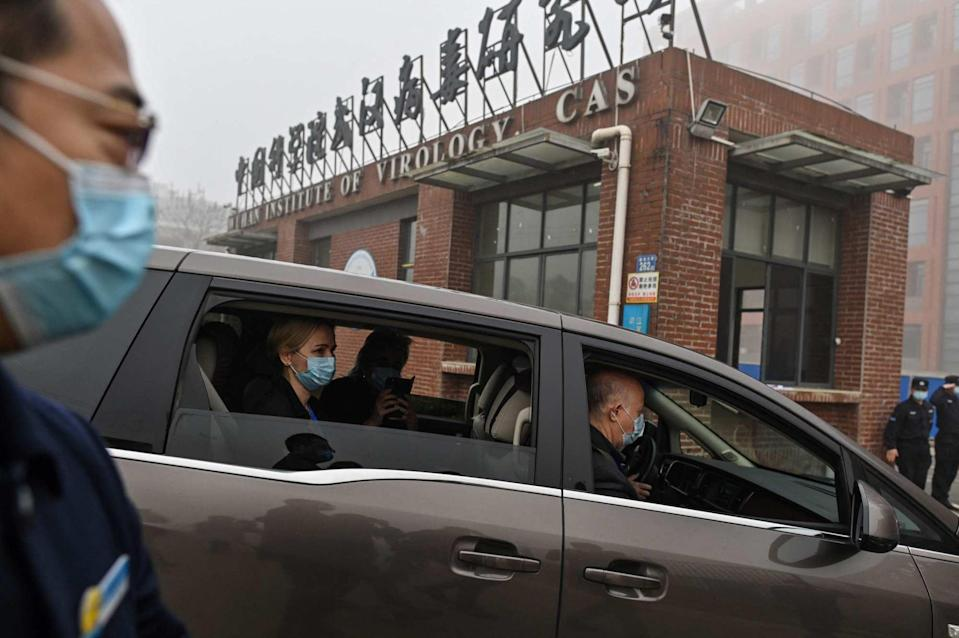 Members of the WHO team arrive at the Wuhan Institute of Virology in February. Photo: AFP