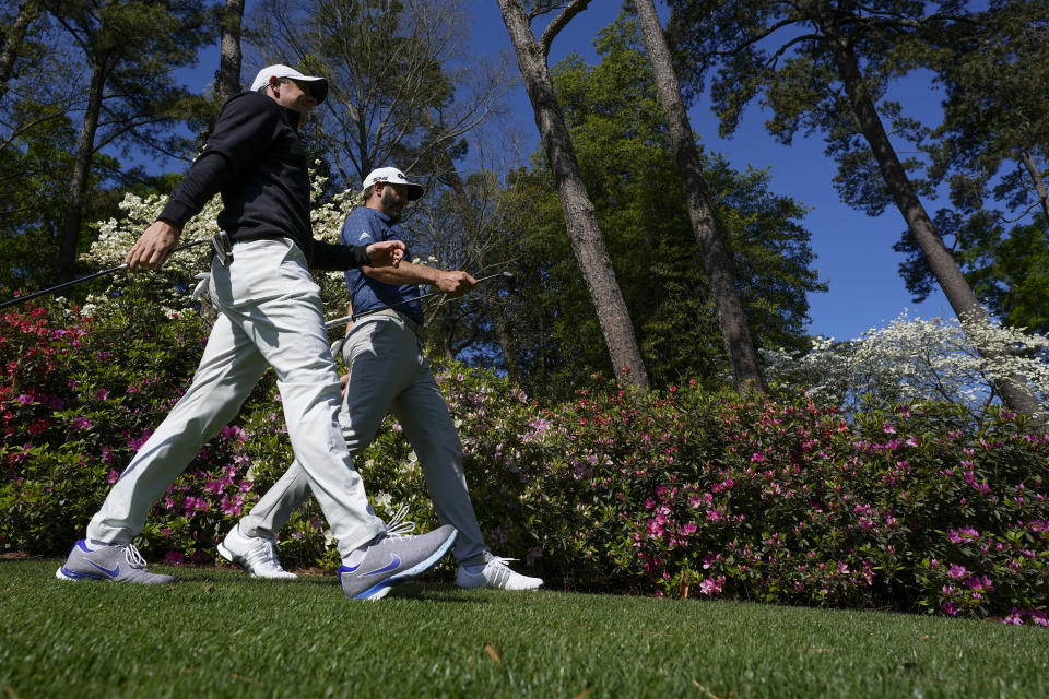 Rory McIlroy, of Northern Ireland, and Dustin Johnson walk along the sixth hole during a practice round for the Masters golf tournament on Monday, April 5, 2021, in Augusta, Ga. (AP Photo/David J. Phillip)
