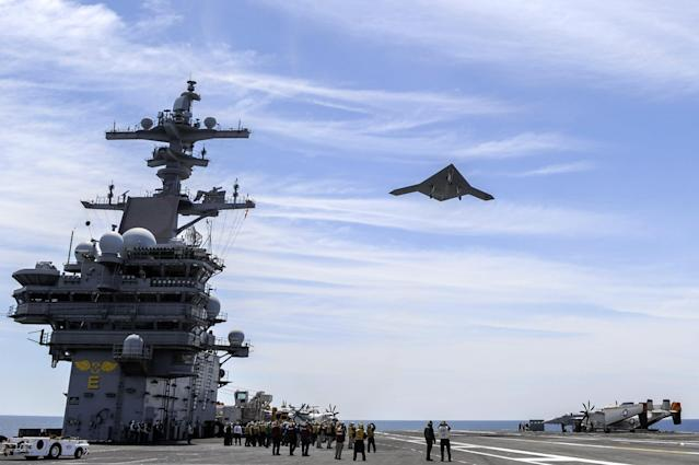 ATLANTIC OCEAN - MAY 14: In this handout released by the U.S. Navy courtesy of Northrop Grumman, an X-47B Unmanned Combat Air System (UCAS) demonstrator flies over after launching from the aircraft carrier USS George H.W. Bush (CVN 77) May 14, 2013 in the Atlantic Ocean. George H.W. Bush is the first aircraft carrier to successfully catapult-launch an unmanned aircraft from its flight deck. The Navy plans to have unmanned aircraft on each of its carriers to be used for surveillance and be armed and used in combat roles. (Photo by Alan Radecki/U.S. Navy/Northrop Grumman via Getty Images)