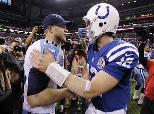 Indianapolis Colts quarterback Andrew Luck (12) is congratulated by Tennessee Titans quarterback Jake Locker (10) following an NFL football game, Sunday, Dec. 9, 2012, in Indianapolis. The Colts won 27-23. (AP Photo/Michael Conroy)