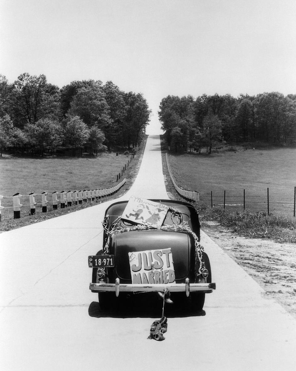 <p>The classic cans-and-Just-Married-sign help send off a couple to a happy life ahead of them. </p>