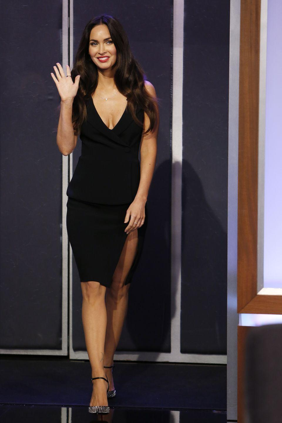 <p>The mother-of-three styled a black plungeneck dress with silver-hued heels for the TV appearance. </p>