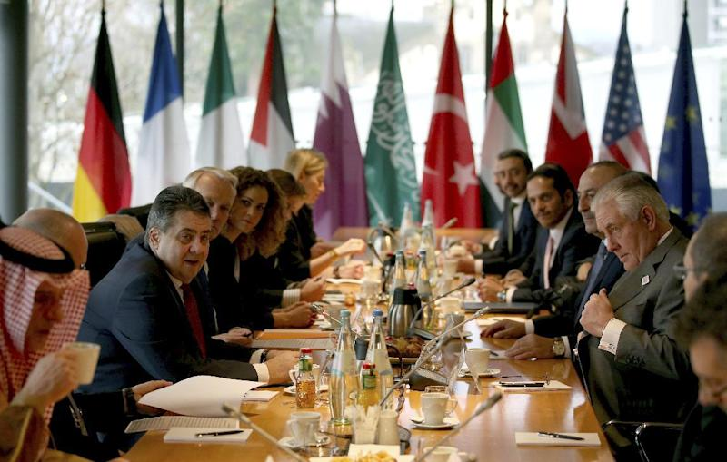 German Foreign Minister Sigmar Gabriel, second from left, and U.S. Secretary of State Rex Tillerson attend a meeting on the conflict in Syria during a meeting of the G-20 Foreign Ministers in Bonn, western Germany, Friday, Feb. 17, 2017. (Oliver Berg/pool photo via AP)