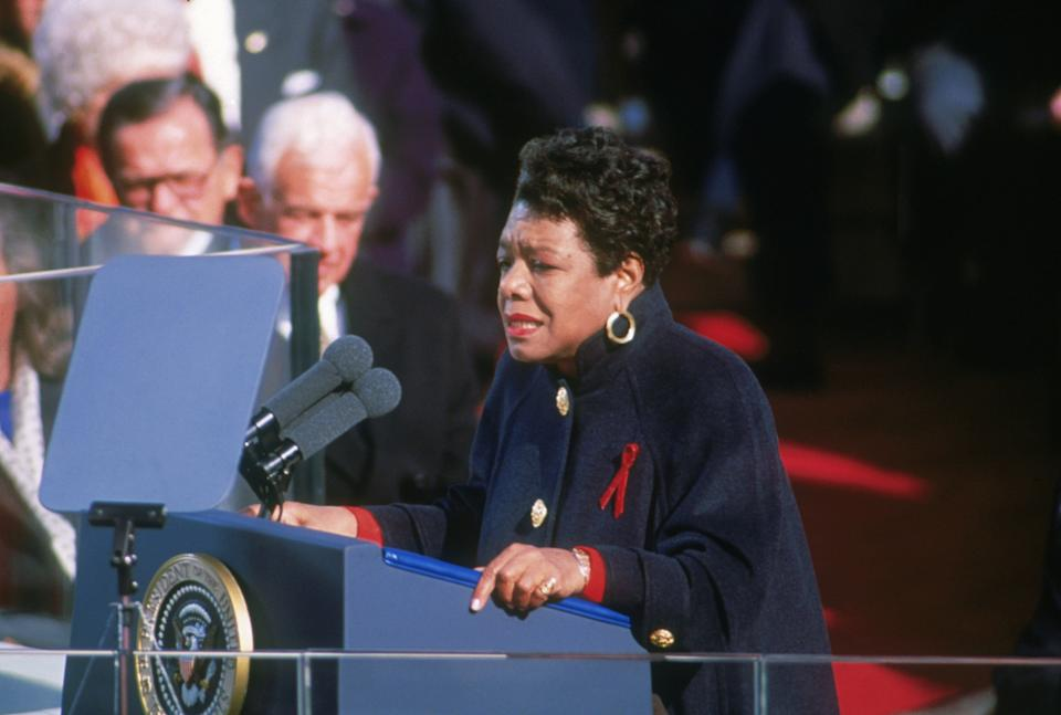 Maya Angelou reciting her poem 'On the Pulse of Morning' at Bill Clinton's inauguration on Jan. 20, 1993. She's wearing a Chanel coat given to her by Oprah Winfrey. (Photo: Consolidated News Pictures via Getty Images)