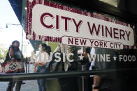 Patrons wait as security personnel check for proof of vaccination as they enter City Winery on Thursday, June 24, 2021, in New York. Customers wanting to wine, dine and unwind to live music at the City Winery's flagship restaurant in New York must show proof of a COVID-19 vaccination to get in. But that's not required at most other dining establishments in the city. And it's not necessary at other City Winery sites around the U.S. (AP Photo/Frank Franklin II)