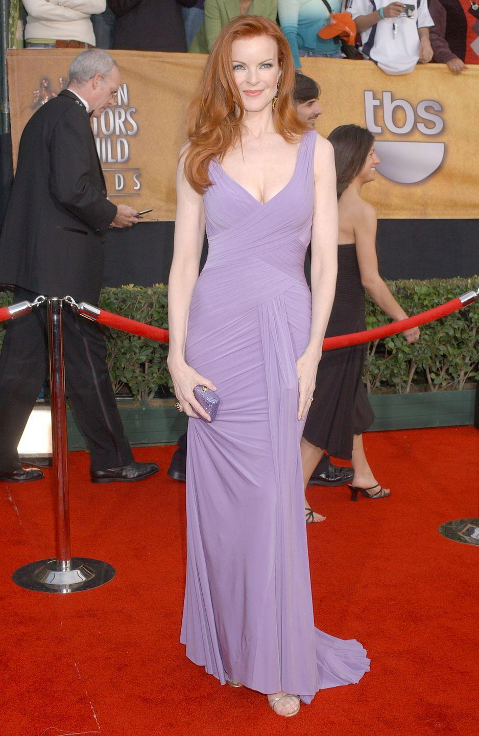 <p>Marcia Cross's wavy red hair and form-fitting lavender dress make her look a whole lot like Meg.</p>