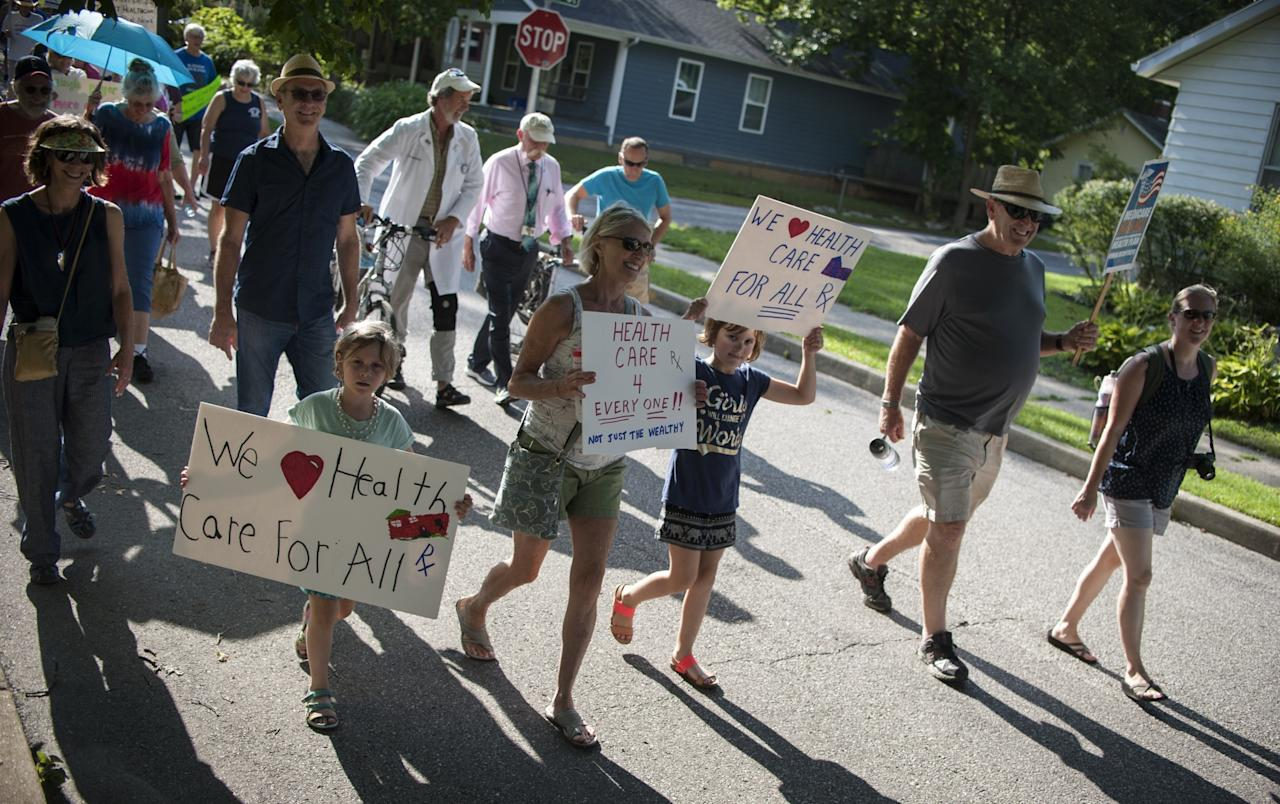 <p>Demonstrators participate in a Medicare For All march in Bloomington, Ind., Monday, July 24, 2017. The group marched from Rose Hill Cemetery to the Monroe County Courthouse. (Photo: Alex McIntyre/The Herald-Times via AP) </p>