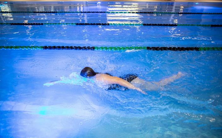 Lisa Phillips, the first swimmer to go for a swim at David Lloyd Hampton club in Twickenham, London as it opens its gym and swimming pools at midinight for the first time since lockdown for members. - Jeff Gilbert