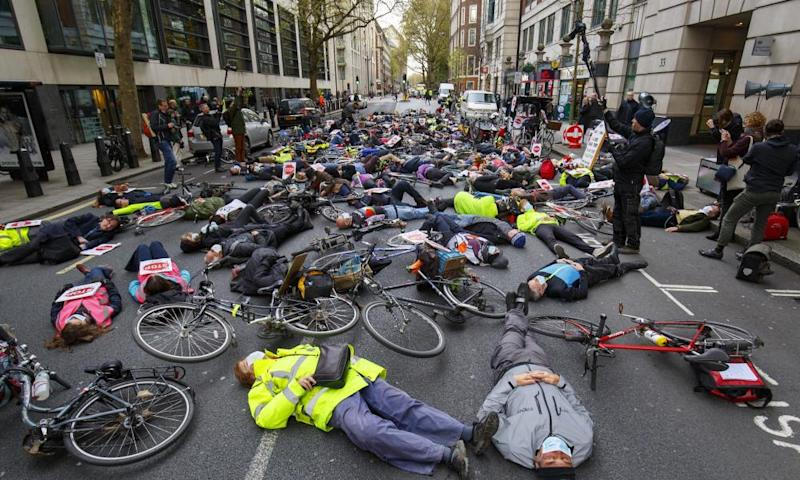 Cycling protesters stage a die-in at an anti-pollution rally in London