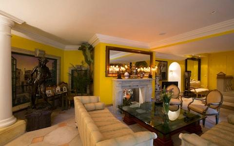 The Venice Lounge is the most formal public space, with its lemon walls, marble fireplace, grand piano and life-size bronze statues - Credit: Heathcliff O'Malley for the Telegraph