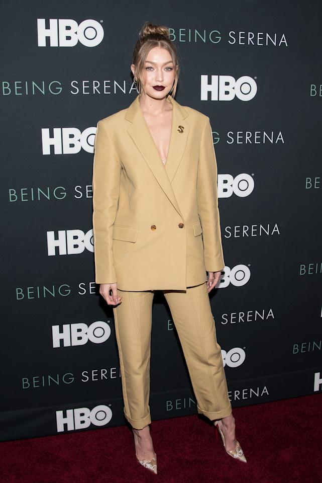<p>Black lippy and an oversized Derek Lam trouser suit worked surprisingly well on the supermodel. <em>[Photo: Getty]</em> </p>