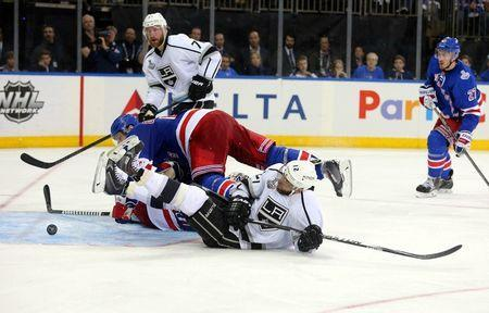 Jun 9, 2014; New York, NY, USA; Los Angeles Kings right wing Marian Gaborik (12) collides with defenseman Dan Girardi (top) as they chase the puck in the crease during the third period in game three of the 2014 Stanley Cup Final at Madison Square Garden. Mandatory Credit: Brad Penner-USA TODAY Sports