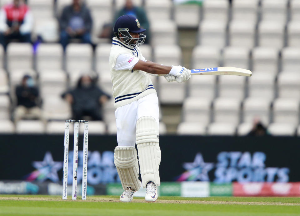 India's Ajinkya Rahane hits a boundary during the second day of the World Test Championship final cricket match between New Zealand and India, at the Rose Bowl in Southampton, England, Saturday, June 19, 2021. (AP Photo/Ian Walton)