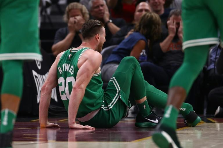 Gordon Hayward of the Boston Celtics sits on the floor after breaking his left leg while playing the Cleveland Cavaliers, at Quicken Loans Arena in Cleveland, Ohio, on October 17, 2017