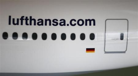 The web address of German air carrier Lufthansa AG is seen on model of a Boing 777 aircraft during the company's annual news conference in Frankfurt