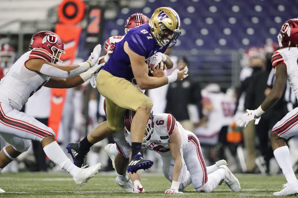 Washington tight end Cade Otton carries the ball against Utah during the second half of an NCAA college football game Saturday, Nov. 28, 2020, in Seattle. Washington won 24-21. (AP Photo/Ted S. Warren)