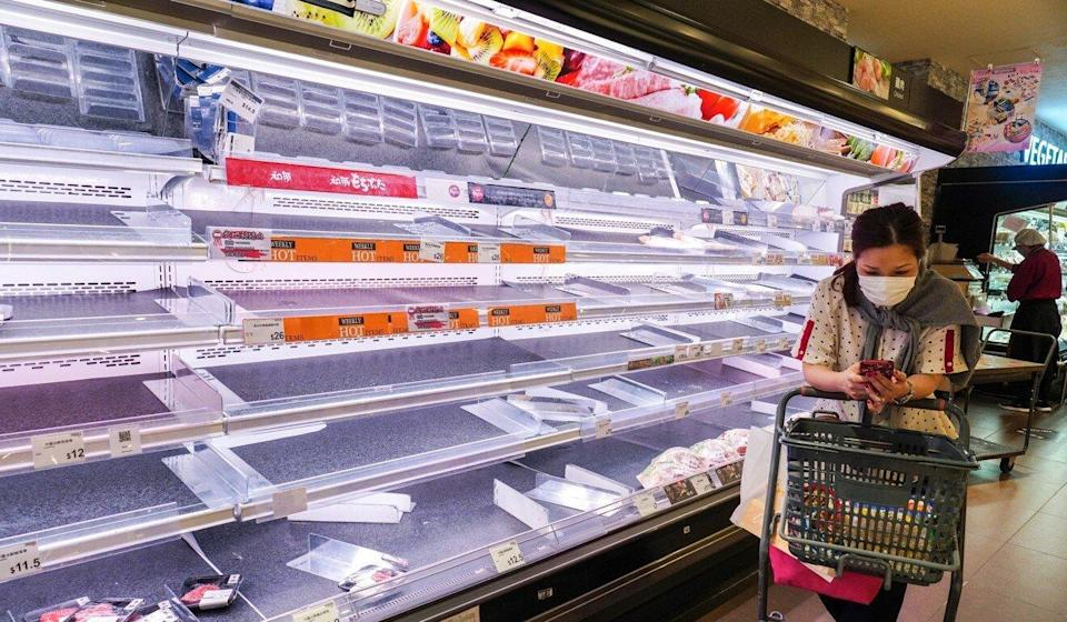A rush of customers on Monday compounded the effects of disruptions over the weekend, leading to empty supermarket shelves around town. Photo: Robert Ng