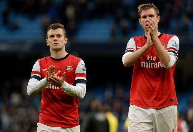 Wilshere and Mertesacker played together for Arsenal.