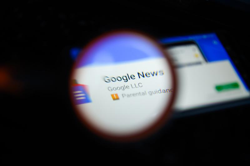 KRAKOW, POLAND - 2018/09/07: In this photo illustration, the Google News app is seen trough a magnifying glass on an android mobile phone. (Photo Illustration by Omar Marques/SOPA Images/LightRocket via Getty Images)