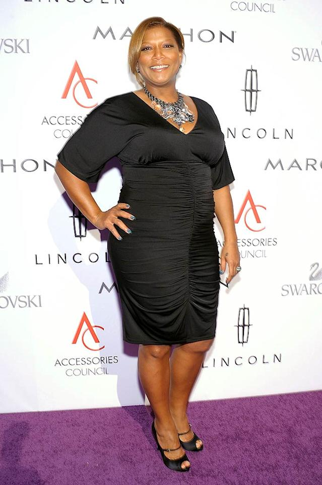 Clad in basic black, singer/actress/designer Queen Latifah also hit the purple carpet. She rubbed elbows with bold-faced names of fashion including Christian Louboutin, John Varvatos, Diane von Furstenberg, and more. (11/7/2011)