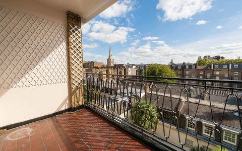 The apartment has a private balcony with views over the peaceful gardens of Eaton Square