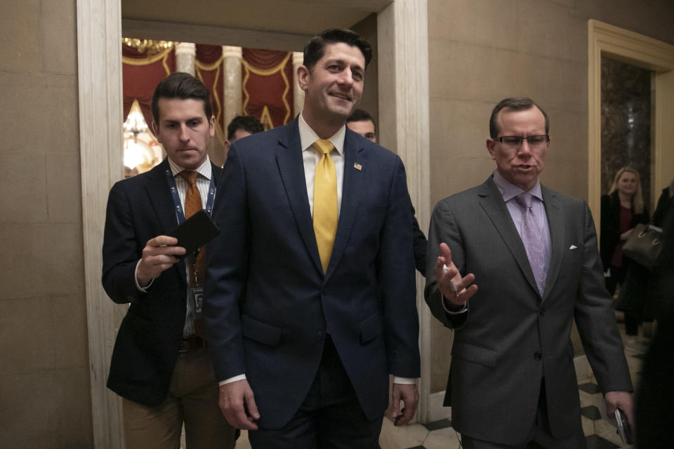 "FILE - In this Dec. 20, 2018 file photo House Speaker Paul Ryan leaves the chamber after the Republican-led House approved funding for President Donald Trump's border wall at the Capitol in Washington. Ryan thinks his divided party, and history, will move on since the chaotic end of Donald Trump's presidency. The either-or debate over fealty to Trump ""is going to fade,"" the 2012 Republican vice presidential candidate said in an interview. ""I think circumstances, ideas and new candidates are going to overshadow that whole conversation."" (AP Photo/J. Scott Applewhite,File)"