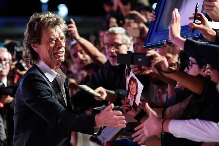 Mick Jagger signing autographs in 2019 but the fans will be kept clear of the red carpet this year