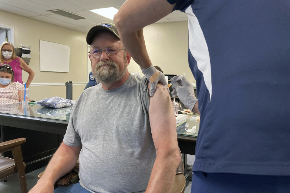 """John Rogers receives a second dose of the COVID-19 vaccine in Taylorsville, Ky., on Thursday, June 17, 2021. Rogers waited months after becoming eligible for the COVID-19 vaccine. It was only after talking with friends that the retiree was persuaded to get the shot. """"They said, 'You know, the vaccine may not be 100%, but if you get COVID, you're in bad shape,'"""" Rogers said. """"You can die from it."""" (AP Photo/Dylan Lovan)"""