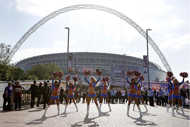 The NFL Allstars cheerleaders perform ahead of the NFL game between the Pittsburgh Steelers and Minnesota Vikings at Wembley Stadium, London, Sunday, Sept. 29, 2013. (AP Photo/Sang Tan)