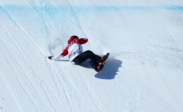 SOCHI, RUSSIA - FEBRUARY 08: Sebastien Toutant of Canada crashes out after his second run during the Snowboard Men's Slopestyle Final during day 1 of the Sochi 2014 Winter Olympics at Rosa Khutor Extreme Park on February 8, 2014 in Sochi, Russia. (Photo by Julian Finney/Getty Images)