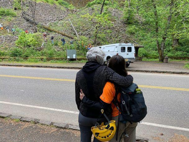 PHOTO: A relative is consoled by a search and rescue member as missing Portland hiker Joe Dean is carried down to the command post after locating him on May 10, 2021, near the Horsetail Falls Trail in Oregon. (Multnomah County Sheriff's Office)